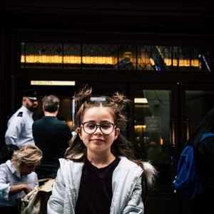 Girl Wearing Glasses Kid Posing Outside Glasses Store
